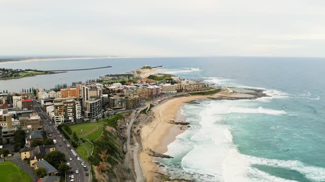 newcastle beach at sunset - australia stock videos & royalty-free footage
