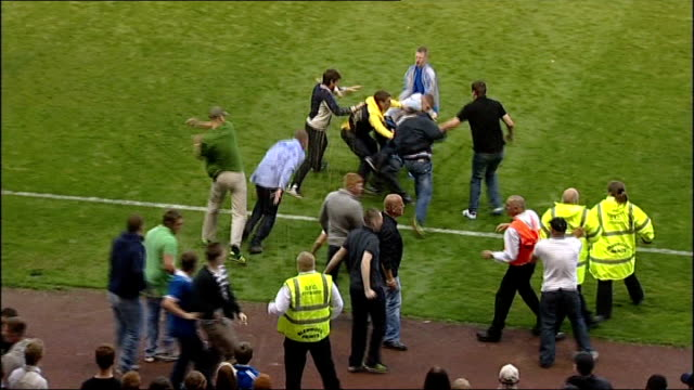 newcastle united fans charged following pitch invasion england county durham darlington darlington arena ext newcastle fans invading pitch during... - hooligan stock videos & royalty-free footage