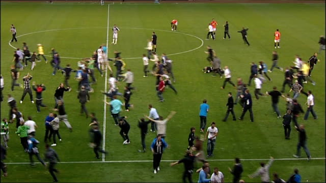 Newcastle United fans charged following pitch invasion ENGLAND County Durham Darlington Darlington Arena Various shots of fans invading pitch during...