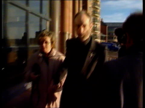 stockvideo's en b-roll-footage met newcastle vicar convicted of attacking wife; england: newcastle: ext rev. michael golightly along to court with wife enid: - newcastle upon tyne