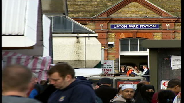 west ham fans petition to save pub entrance to upton park station with name over pull out to pub in f/g - west ham fc stock-videos und b-roll-filmmaterial