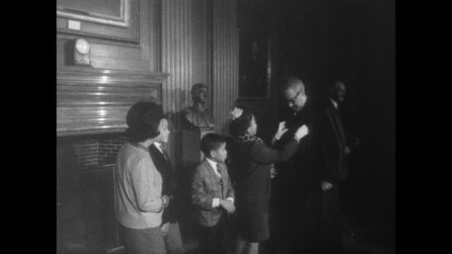 newly appointed justice of the supreme court thurgood marshall has help adjusting his robe from wife cecilia suyat / poses with family in front of... - supreme court justice stock videos & royalty-free footage