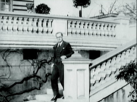 stockvideo's en b-roll-footage met newly appointed us ambassador to great britain joseph p kennedy sr ascending outdoor marble steps stopping at landing / joseph kennedy speaking to... - 1938