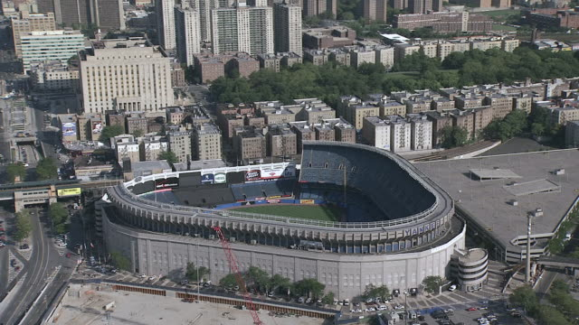 AERIAL Newly constructed Yankee Stadium next to old Yankee Stadium / New York City, New York, United States