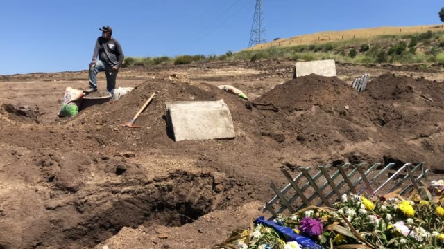 newly dug graves at tijuana municipal cemetery 13 amid the covid-19 pandemic on may 11, 2020 in tijuana, mexico. a cemetery official said the number... - cemetery stock videos & royalty-free footage