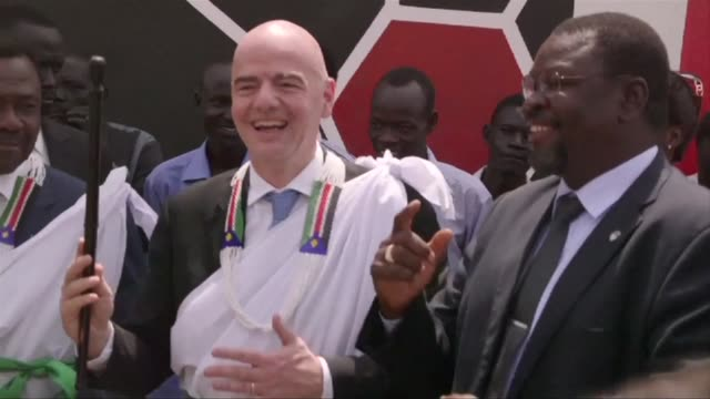 vídeos de stock, filmes e b-roll de newly elected fifa president gianni infantino visits war torn south sudan the worlds newest nation on one of his first official trips since taking up... - gianni infantino