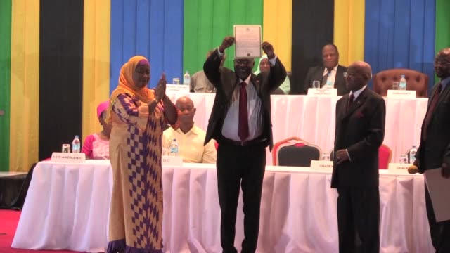 newly elected john pombe magufuli is officially announced as the next president of the republic of tanzania receiving a certificate of winning from... - president stock videos & royalty-free footage