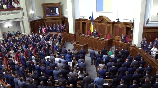 newly elected lawmakers sing the national anthem during the first session of newly ukrainian parliament in kiev, ukraine, on 29 august, 2019.... - legislator stock videos & royalty-free footage