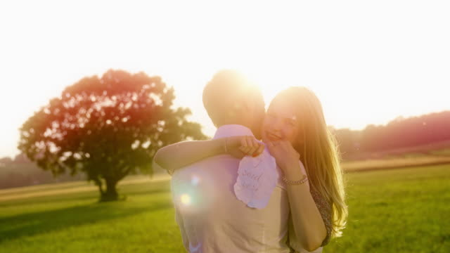 newly engaged couple embracing - yes single word stock videos & royalty-free footage