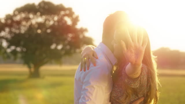 newly engaged couple in meadow - yes single word stock videos & royalty-free footage