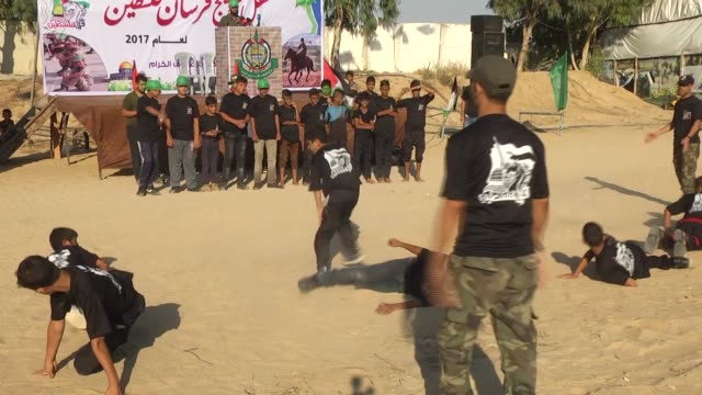newly graduates palestinian trainees perform military drill during their graduation ceremony of the summer camp of izz addin alqassam brigades... - hamas stock videos & royalty-free footage