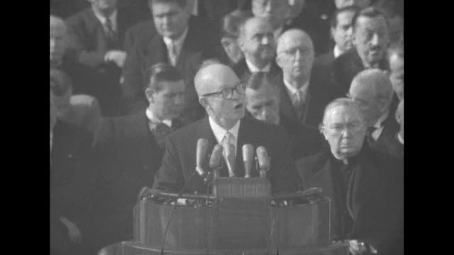newly inaugurated president dwight eisenhower standing at podium on east portico of us capitol speaking officials sitting behind him / two shots of... - herbert hoover us president stock videos & royalty-free footage