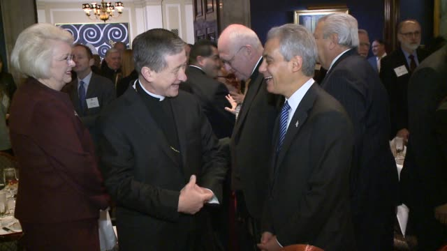 newly inducted archbishop blase cupich and mayor rahm emanuel talk before a breakfast at the union league club of chicago on nov 20 2014 - archbishop stock videos & royalty-free footage