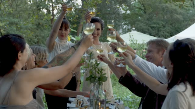 Newly Lesbian couple toasting at their wedding