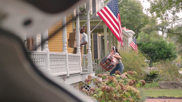 a newly married multi-ethnic couple carry belongings into their new home - wilmington north carolina stock videos & royalty-free footage