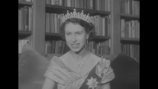 newly proclaimed queen elizabeth in gown, medals on sash, diamond tiara and necklace - elizabeth ii stock videos & royalty-free footage
