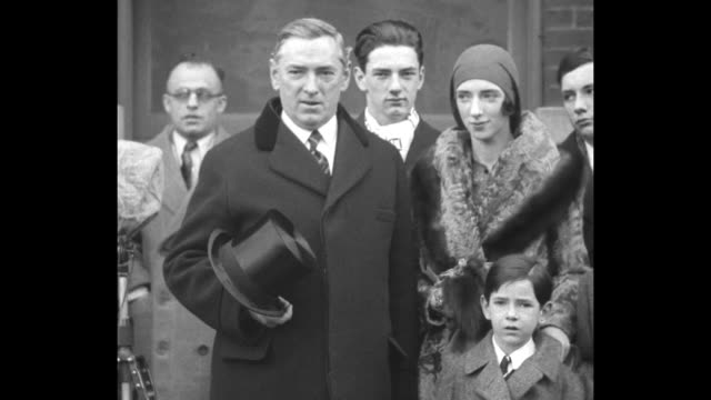 newly reelected mayor of boston james michael curley stands outside building with two of his sons and his wife mary emelda as he speaks he holds a... - top hat stock videos & royalty-free footage