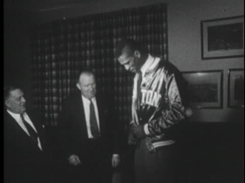 newly signed boston celtic player bill russell models his team's warm-up jacket after signing his first professional contract with the boston celtics. - healthcare and medicine or illness or food and drink or fitness or exercise or wellbeing stock videos & royalty-free footage