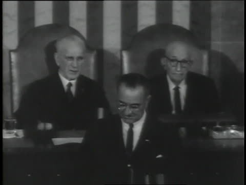 "newly sworn in u.s. president lyndon b. johnson speaks to a joint session of congress and refers to the death of assassinated president john f. kennedy, saying ""america must move forward."" - john f. kennedy us president stock videos & royalty-free footage"