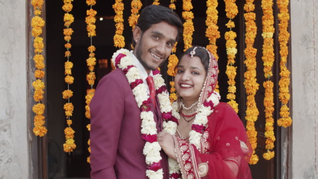 newly wed bride and groom in their formal wedding attire in rural india - short phrase stock videos & royalty-free footage