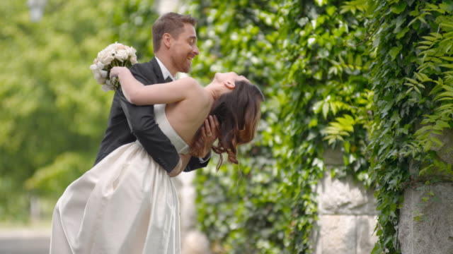 SLO MO Newly wedded couple dancing outside on wedding day