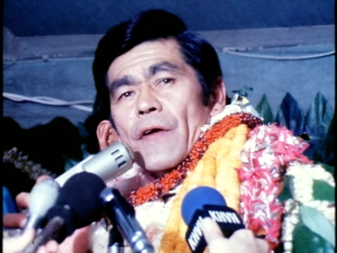 newly-elected hawaiian governor, george ariyoshi, wearing numerous leis and speaking to members of the media/ hawaii islands, usa/ audio - only mature men stock videos & royalty-free footage