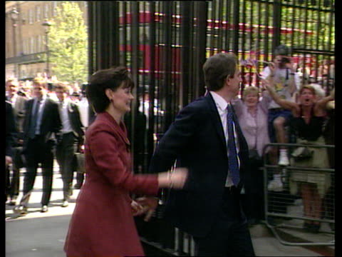 newlyelected prime minister tony blair with wife cherie entering downing street and greeting jubilant crowds 1997 general election 02 may 97 - tony blair stock-videos und b-roll-filmmaterial