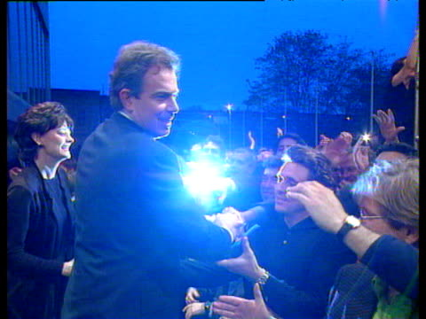 stockvideo's en b-roll-footage met newlyelected prime minister tony blair with wife cherie greeting jubilant crowds at royal festival hall at dawn 1997 general election 02 may 97 - tony blair