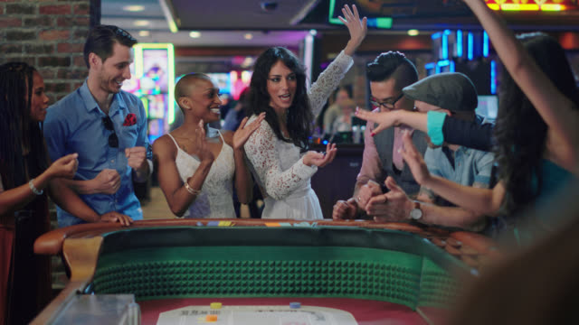 newlywed bride throws dice while playing craps with their friends and celebrates winning in a las vegas casino after eloping - craps stock videos & royalty-free footage