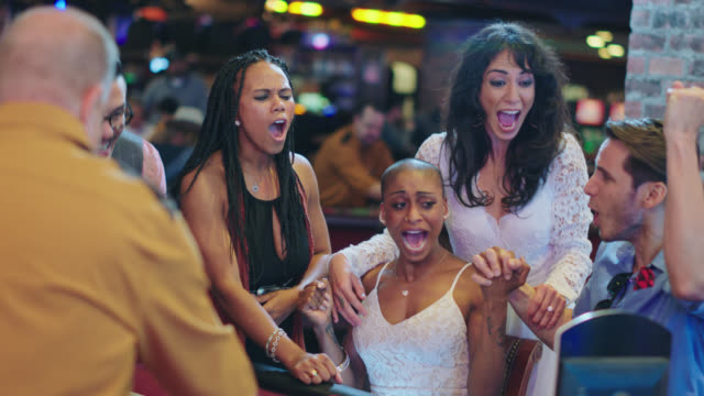 newlywed brides and their friends celebrate winning roulette in a las vegas casino after eloping - roulette stock videos & royalty-free footage
