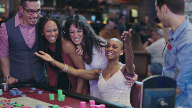 slo mo. newlywed brides and their friends celebrate winning roulette in a las vegas casino after eloping - gambling chip stock videos & royalty-free footage
