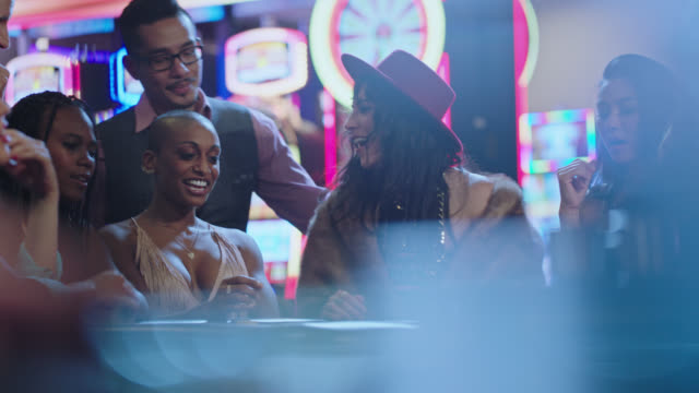 newlywed brides play blackjack with their friends in a las vegas casino after eloping and are disappointed when they lose that hand - casino stock-videos und b-roll-filmmaterial