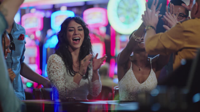 slo mo. newlywed brides play blackjack with their friends in a las vegas casino after eloping and celebrate after winning - blackjack video stock e b–roll