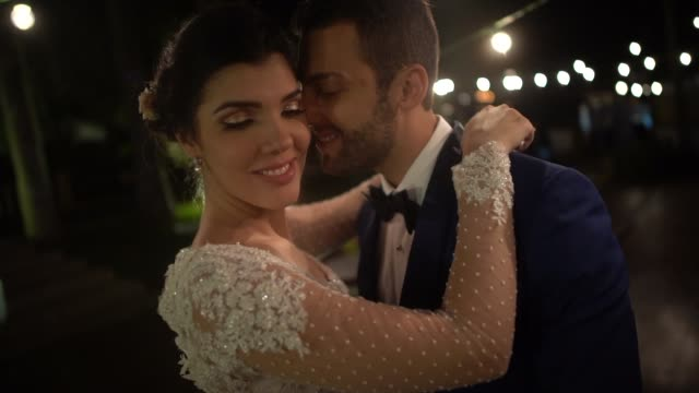 newlywed couple dancing under the lights - dress stock videos & royalty-free footage