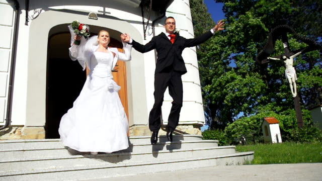 HD SUPER SLOW-MO: Newlywed Couple Jumping Off Stair