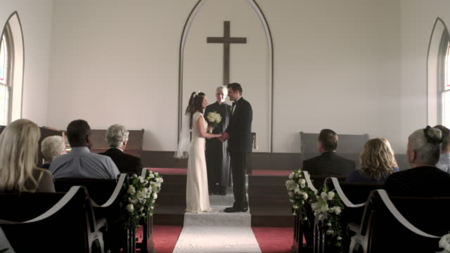 newlywed couple kisses and walks down the aisle. - just married stock videos and b-roll footage