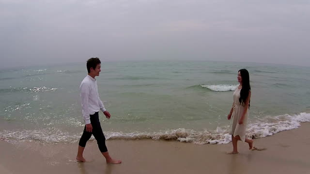 newlywed couple posing at jeju island beach - korean ethnicity stock videos & royalty-free footage