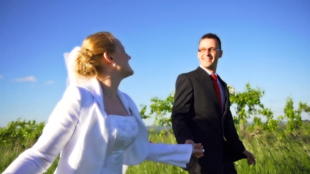 hd super slow-mo: newlywed couple running - groom stock videos and b-roll footage