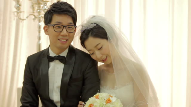 newlywed korean bride leaning her head on grooms shoulder - korean ethnicity stock videos & royalty-free footage