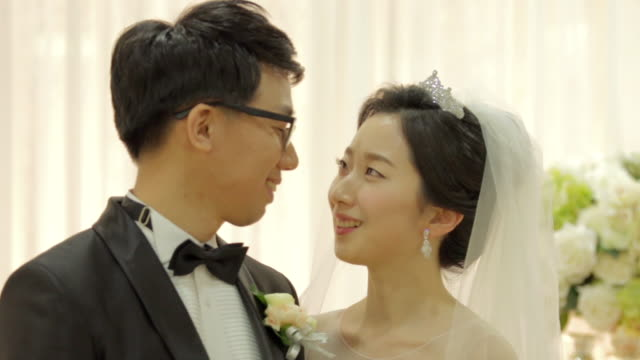 newlywed korean couple facing and talking to each other - korean ethnicity stock videos & royalty-free footage