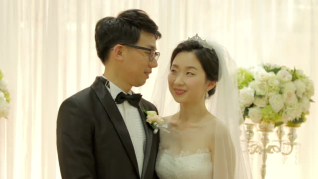 newlywed korean couple facing each other for the camera - other stock videos & royalty-free footage