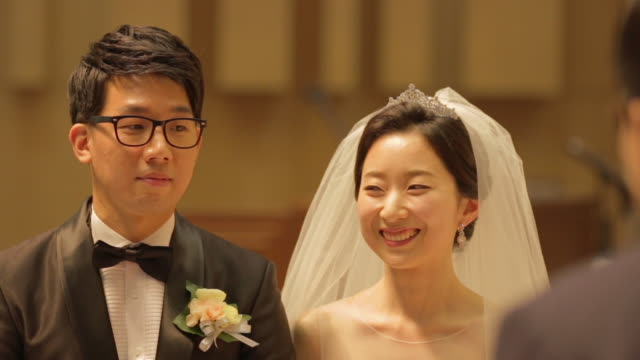 newlywed korean couple smiling in front of somone - south korea couple stock videos & royalty-free footage