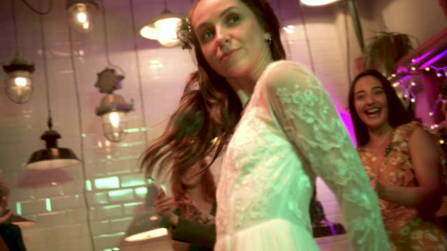 newlywed lesbian bride doing funny walk at wedding reception - three quarter length stock videos & royalty-free footage