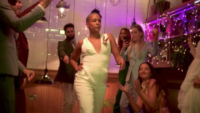 newlywed lesbian bride doing funny walk at wedding reception - three quarter length stock videos & royalty-free footage