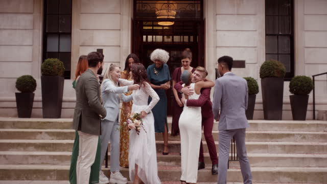 newlywed lesbian couple celebrating their marriage with friends - 20 29 years stock videos & royalty-free footage