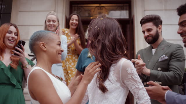 newlywed lesbian couple celebrating their marriage with friends - three quarter length stock videos & royalty-free footage