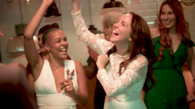 newlywed lesbian couple dancing and cheering at wedding reception - three quarter length stock videos & royalty-free footage