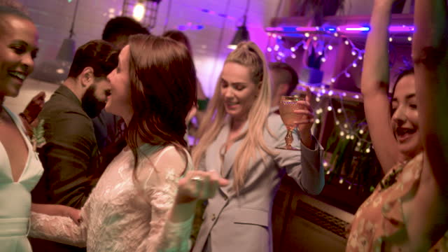 newlywed lesbian couple dancing at wedding reception - celebration stock videos & royalty-free footage