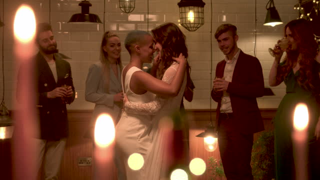 newlywed lesbian couple dancing at wedding reception - three quarter length stock videos & royalty-free footage