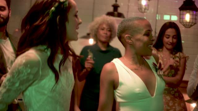 newlywed lesbian couple dancing at wedding reception - three quarter length stock videos & royalty-free footage